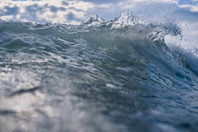 A wave cresting in the ocean