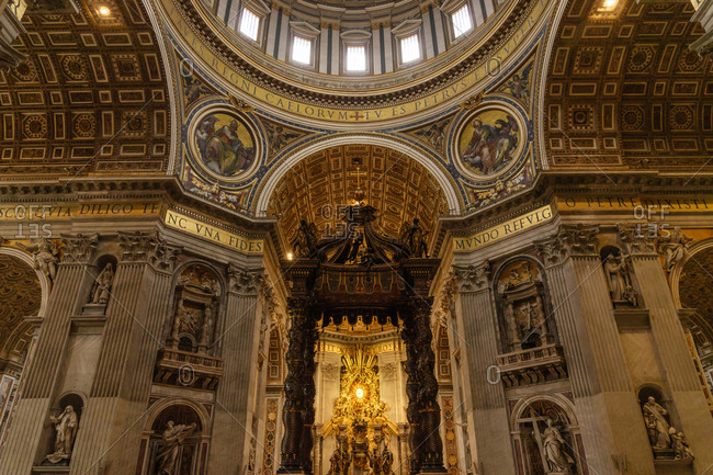Gilded paintings and domed ceiling by the Papal Altar in St. Peter's Basilica, Vatican
