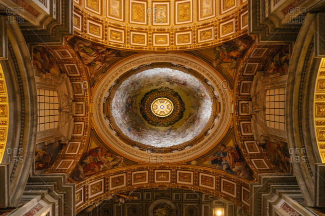 Looking up at a domed ceiling inside St. Peter's Basilica, Vatican
