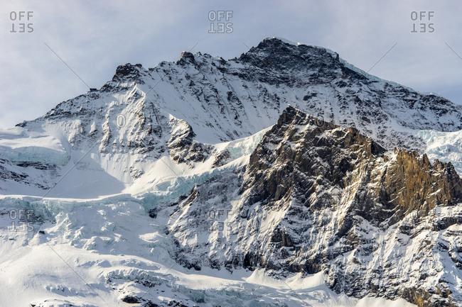 The snowy Kleine Scheidegg mountain pass in the Swiss Alps