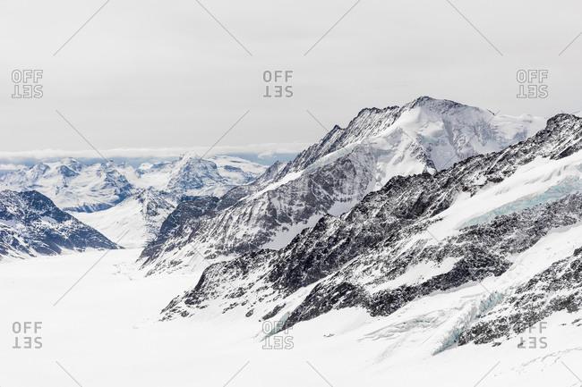 Snow blanketing the peaks of the Swiss Alps