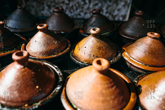Traditional Moroccan earthenware cookery in outdoor market