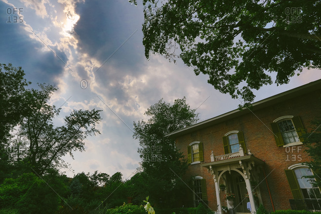 Stately brick mansion and green landscaping