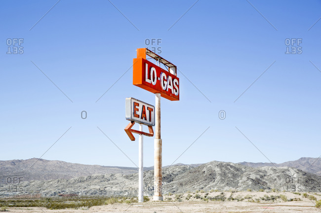 Abandoned gas station sign beside a highway in California