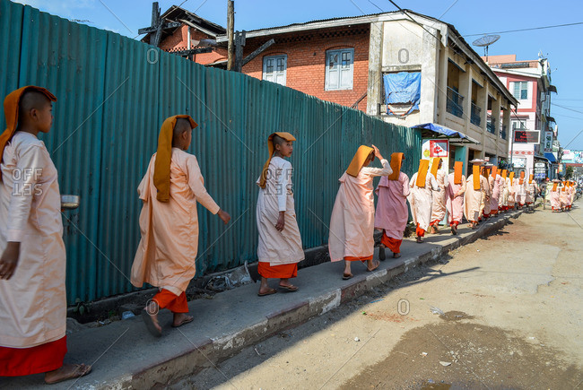 Myanmar - January 22, 2014:Buddhist nuns walking in procession