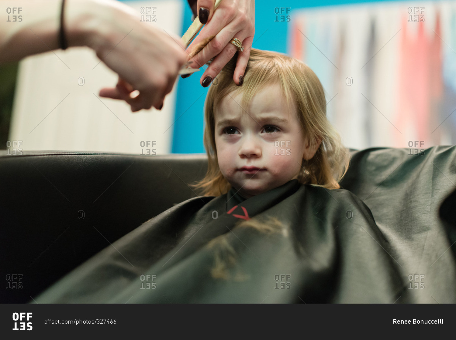 Little Girl Getting A Haircut Close Up Stock Photo Offset