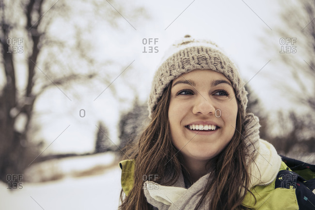 Portrait of a young woman wearing a knit hat in winter