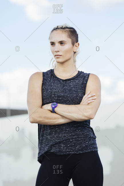 Athletic woman standing with arms crossed