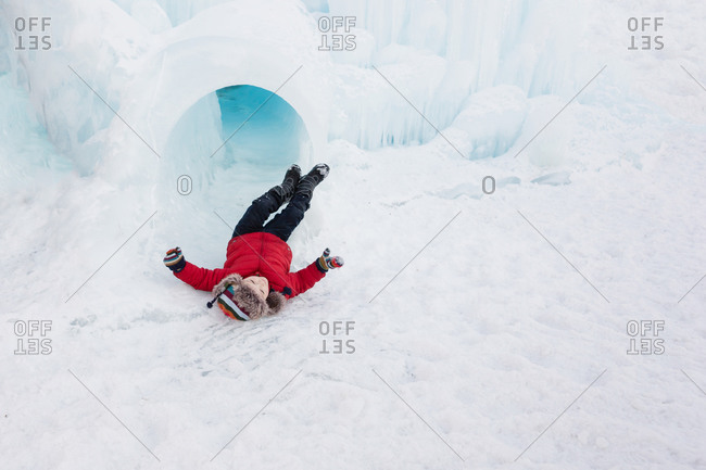 Boy lying on his back in the snow