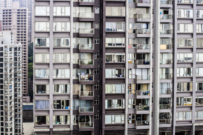 Balconies and windows of residential high-rise building in Hong Kong