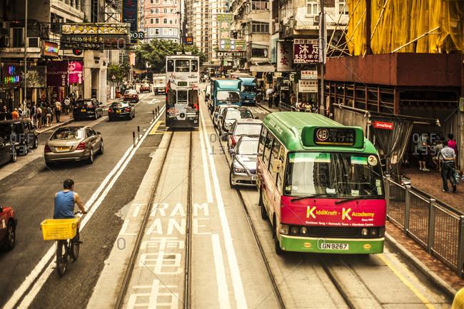 Hong Kong, China - May 24, 2015: Double deck tram and traffic on a street in Hong Kong