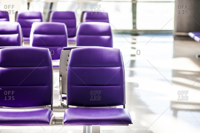 Rows of seats at a modern airport terminal