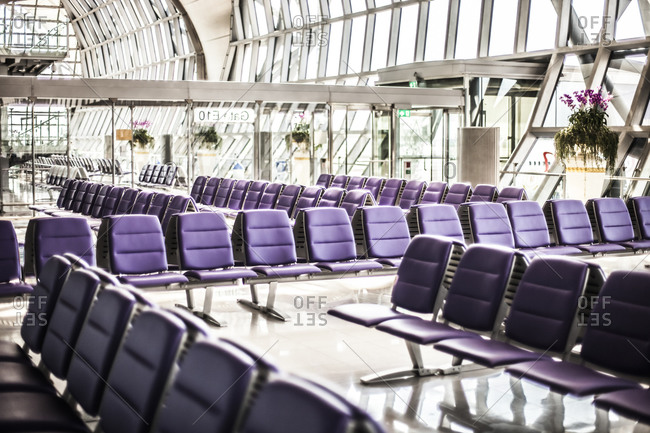 Rows of seats lined up at a modern airport terminal