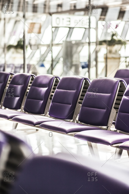Rows of purple seats at a modern airport terminal