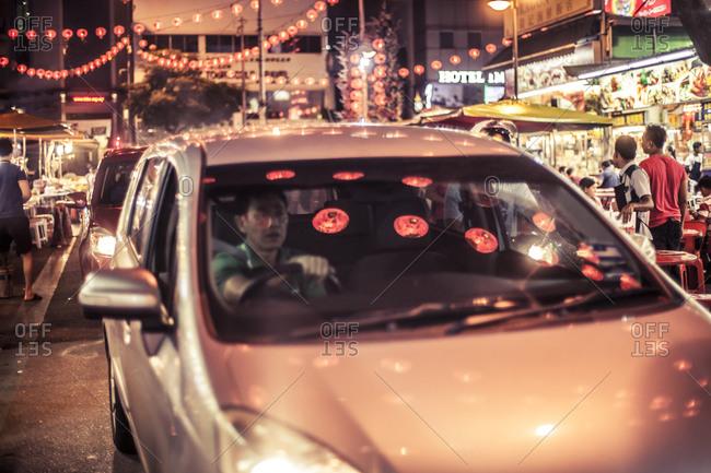 Kuala Lumpur, Malaysia - December 1, 2015: Car driving through Jalan Alor, Kuala Lumpur's famous food street