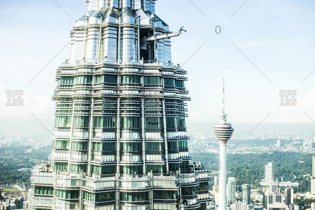 Kuala Lumpur, Malaysia - December 1, 2015: Close-up of the Petronas Towers and Kuala Lumpur skyline