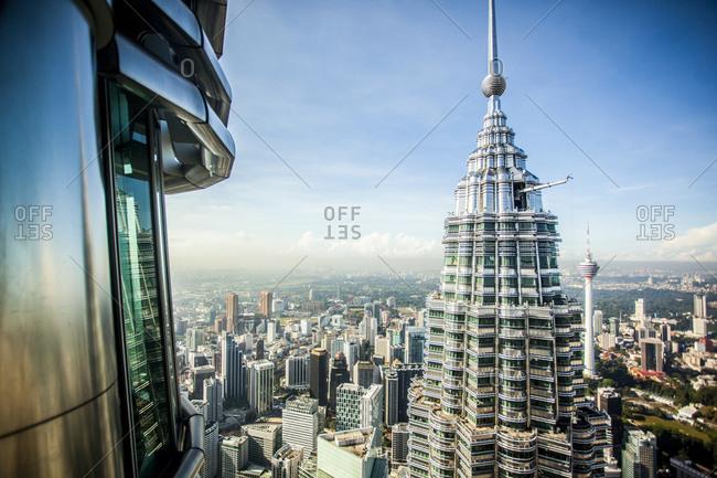 Kuala Lumpur, Malaysia - December 1, 2015: Petronas Towers and Kuala Lumpur skyline