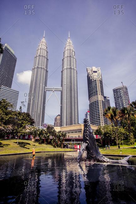 Kuala Lumpur, Malaysia - December 1, 2015: Whale statue and Petronas Towers in Kuala Lumpur