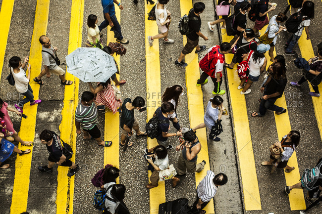 Hong Kong, China - August 15, 2015: Overhead view of people crossing a street in a crosswalk