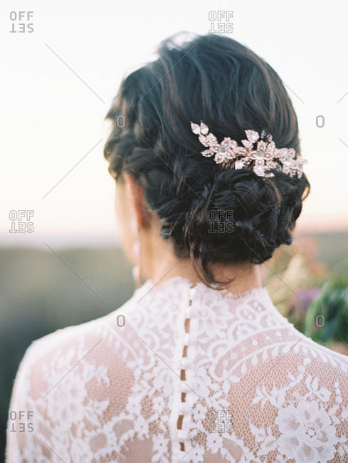 Portrait of a bride's hair and wedding dress from behind