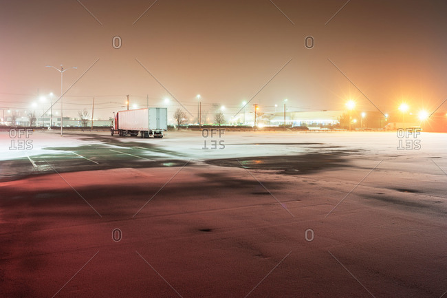 Lone truck in winter parking lot