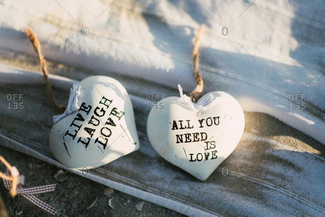 Decorative heart ornaments on beach blanket