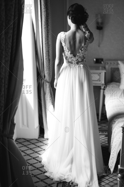 Back view of bride in lace-topped gown