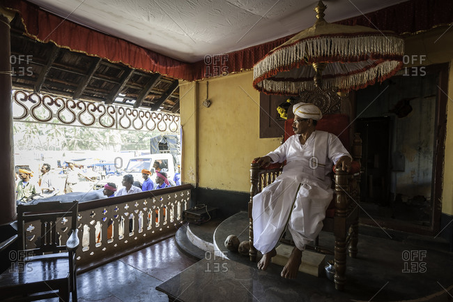 Village chief overseeing the preparations for a traditional Kambala race in Karnataka, India