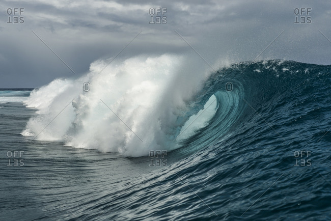Large breaking wave in the Pacific Ocean by Moorea Island, French Polynesia