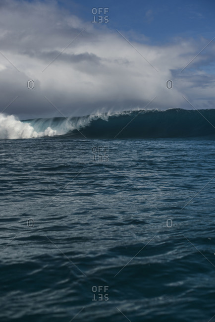 Waves rolling in the Pacific Ocean by Moorea Island, French Polynesia