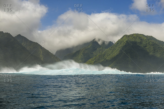 Waves crashing into the shore of Moorea Island, French Polynesia
