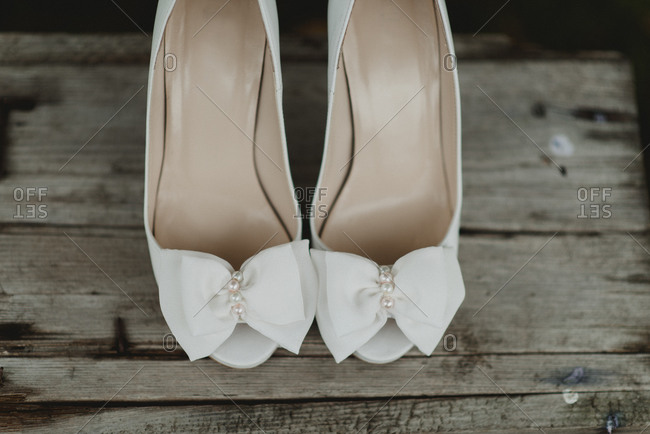 White open toe flats and weathered wood
