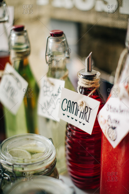 Rustic bottles of liquor labeled with tags on bar