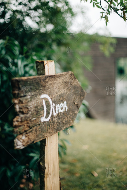 Sign labeled in French pointing to wedding reception