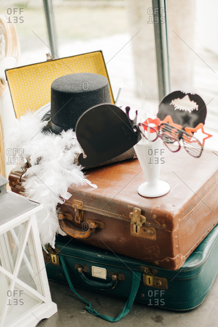 Vintage suitcases with costumes and props for wedding reception