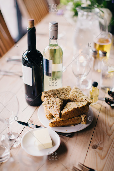 Elevated view of scones on table with bottles of wine