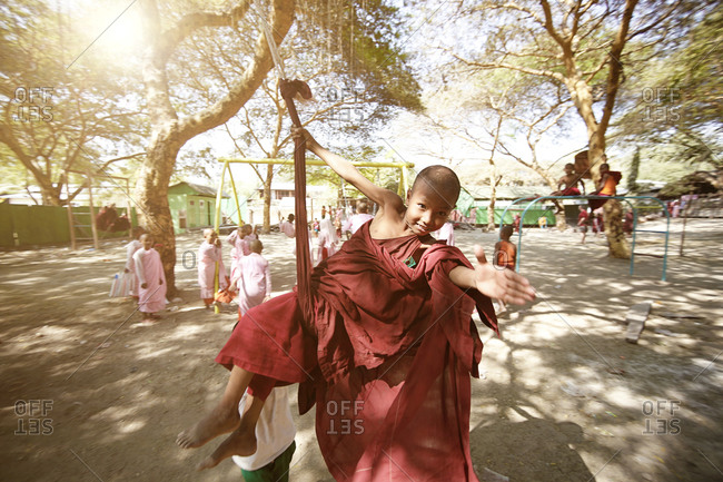 myanmar, mandalay, myanmar - February 28, 2015: Students in the monk school are playing in the school yard