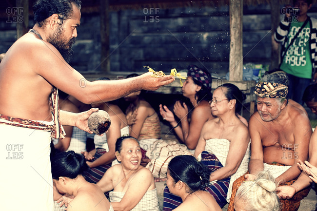 ubud, bali, indonesia - February 10, 2015: Hindu monks blessing the people in the village marriage ceremony