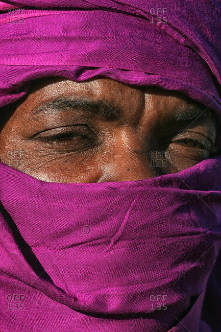 Wilaya, Algeria - December 29, 2004: Portrait of a Tuareg in a fuchsia head cover