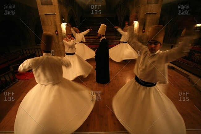 Goreme, Cappadocia, Turkey - April 30, 2000: Sufis of the Mevlevi order perform in a cave