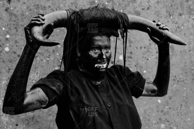 Luzon, Guadalajara, Spain - March 1, 2014: Person in costume for the Devils festival