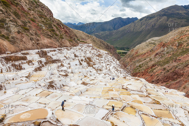 Workers in the salt flats at Salinas, in the village of Maras, near Ollantaytambo, Peru
