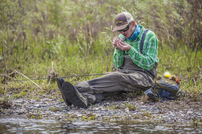 Montana, USA - June 19, 2014: A young man changes rigs Missouri River