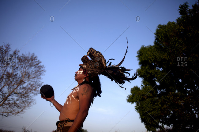 Chapab de las Flores, Yucatan, Mexico - May 25, 2015: A player of Mayan Ball Game holding the ball as he poses