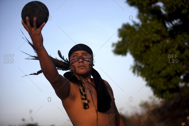 Chapab de las Flores, Yucatan, Mexico - May 25, 2015: A player of Mayan Ball Game holding out a ball
