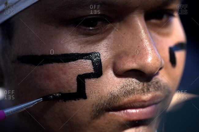 Piste, Yucatan, Mexico - September 19, 2015: A Mayan Ball Player from Chapab team paints his face