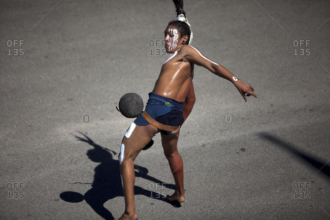 Piste, Yucatan, Mexico - September 19, 2015: A Mayan Ball Player hitting the ball