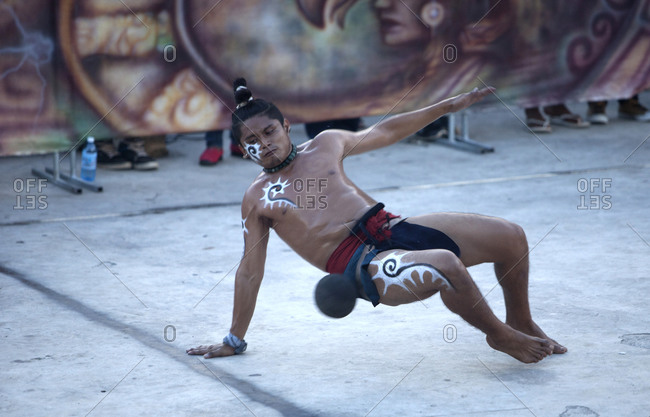Vila Ruiva, Beja, Portugal - September 19, 2015: A Mayan Ball Player from 'Pucxical Keej' team from, Playa del Carmen, Quintana Roo, hits the ball