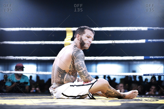Barcelona, Barcelona, Spain - June 12, 2010: Defeated MMA fighter in the ring