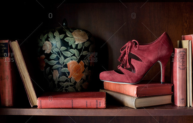 High heel on a bookshelf